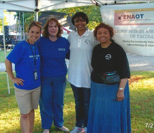 Two Multicare Staff with Ebony Nurses Association volunteers-Michelle Goodwater and Shirley Aikin during the Ethnic Fest, July 2013.